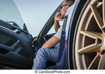 Men Making Road Assistance Phone Call From His Exotic Car
