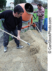 Men mixing cement