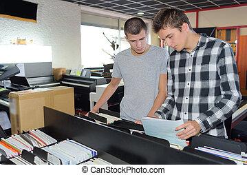 men on a room of folders