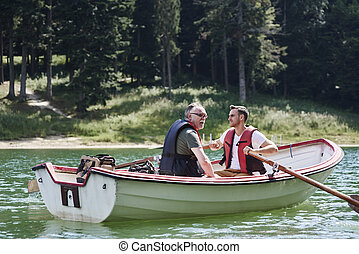 Men on a rowboat during fishing trip