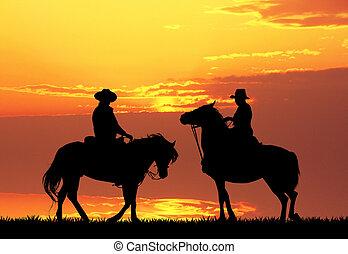 Men on horses ay sunset