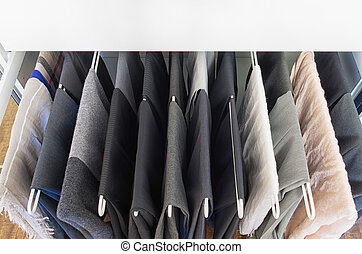Men pants on a metal pull out rack