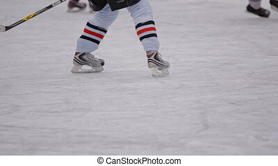 Men play hockey on the hockey field with enthusiasm. body...