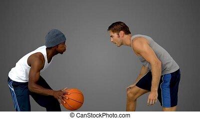 Men playing at basketball