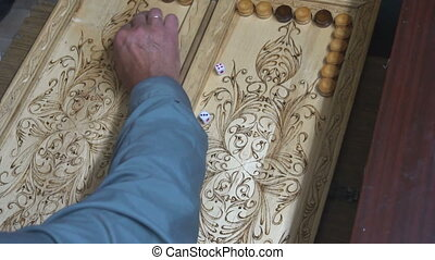 men playing backgammon,wooden Board,roll the dice - men...