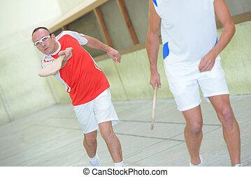 Men playing Basque pelota