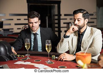 Men playing cards in a casino