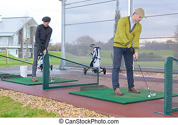 men playing golf in golf course