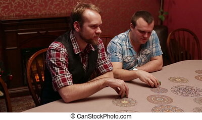 Men playing poker in a casino - People playing poker in the...