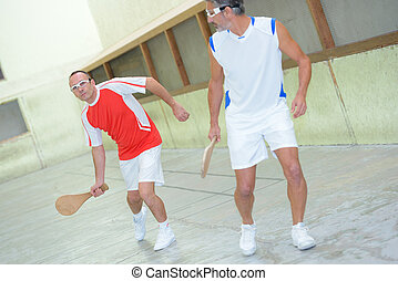 Men playing racket sport