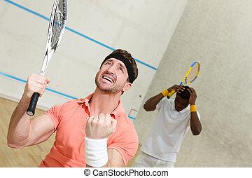 Men playing squash - Handsome squash player man expressing...