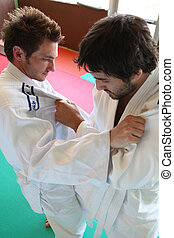 Men practicing judo