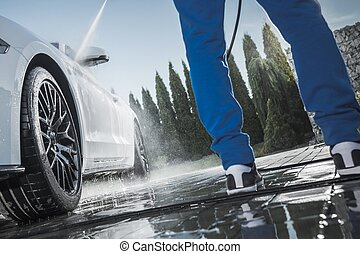 Men Pressure Washing Car