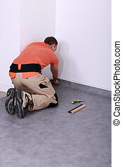 Men putting carpet