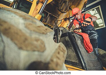 Men Repairing Small Dozer - Caucasian Heavy Equipment ...