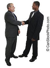 Men Shaking Hands - Two men in suits shaking hands. Shot in...