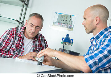 men signing a contract at office