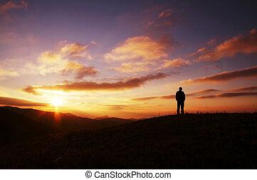 Men silhouette on sunset