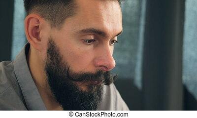 Men sneezes closeup
