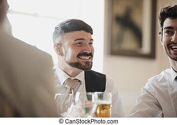 Men Socialsiing At Wedding Reception