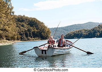 Men spending time in fishery