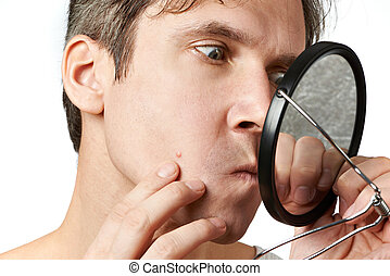Men squeezing a pimple on white background