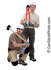 Men stood with tools