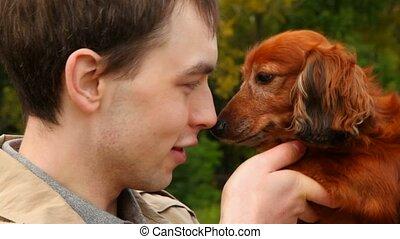 men talking with dog
