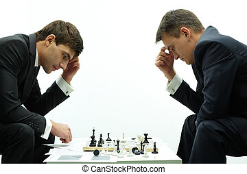 Men thinking - Image of two businessmen thinking of move...