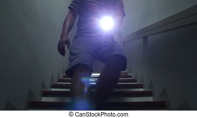 Men using flashlight after power outage