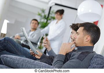 men waiting at a clinic