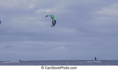 Men wakeboarding on the beach - A long shot of two man...