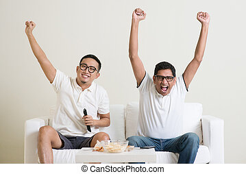 Men watching football game together