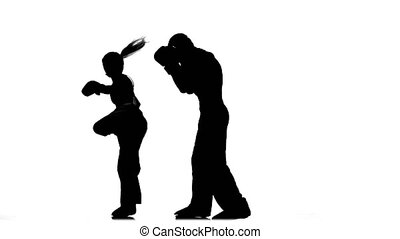 Men with a girl boxing gloves beating in the ring . Silhouette. White background