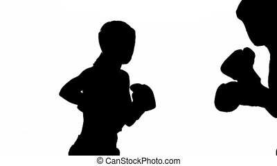 Men with a girl boxing gloves beating in the ring ....