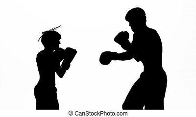 Men with a girl kickboxing gloves beating in the ring ....