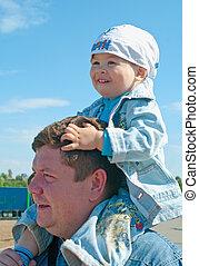 Men with a little boy