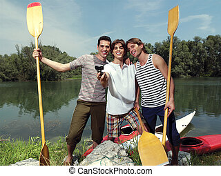 men with canoe in nature io