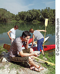 men with canoe in nature l