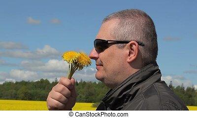 Men with dandelions