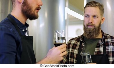 men with drinking and testing beer at brewery - alcohol...