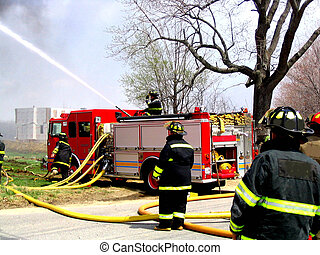 Men Working - , Firefighters working at the scene of a fire