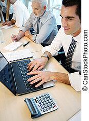 Men working in an office