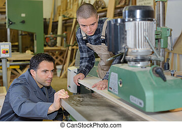 Men working in industrial workshop