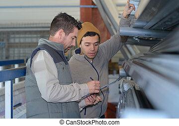 men working in newspaper factory