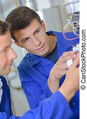 men working on some wirings