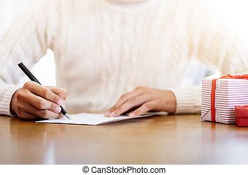 Men writing greeting cards during christmas and new year.