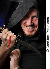 menacing man - medieval looking menacng man with dagger...
