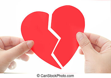 Hand bringing together heart broken into two pieces