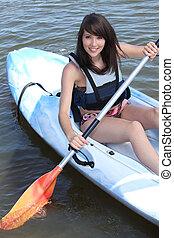 menina adolescente, canoa
